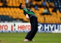 Kevin O'Brien lets out a roar after taking the catch to dismiss Warner