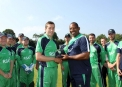 Peter Chase receives first cap from Phil Simmons ©Barry Chambers