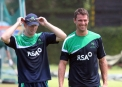 Andrew White makes Max Sorensen laugh © Cricket Ireland/Barry Chambers