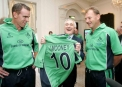 Bertie Aherne presented with an Ireland cricket shirt by Trent Johnston and Adi Birrell  © Inpho