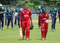 Zimbabwean batsmen leave the field at the end of the match © INPHO/Barry Chambers