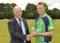 Brian Walsh, Chairman of the Northern Cricket Union made a presentation to Andrew White for reaching 200 caps for Ireland. © Rowland White