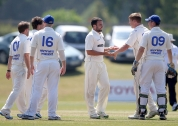 North West Warriors players celebrate taking a wicket ©INPHO/Donall Farmer