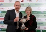 Southern XI U-17 coach Kenny Carroll is presented with the Des Cashell Perpetual Cup by Gemma Cashell ©INPHO/Ryan Byrne