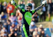 John Mooney celebrates hitting the winning runs in the World Cup opener.
