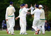 Ireland's John Mooney celebrates a wicket with teammates