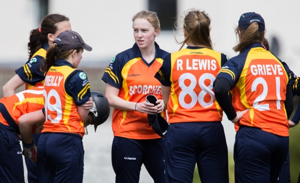 Garth speaks to her team after picking up another wicket