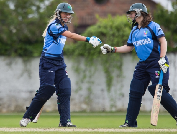 McKenna and Amy Kenealy celebrate a good over