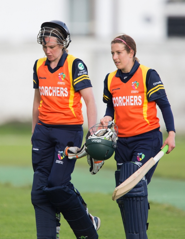 Meg Kendal and Isobel Joyce leaving the field after securing victory.